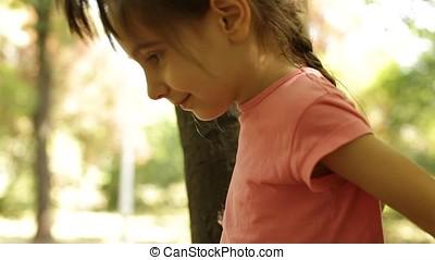 Portrait of Little Girl in Tree