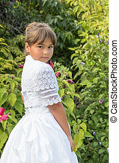 Portrait of  little girl in white bridesmaid clothes
