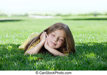 portrait of little girl laying on t