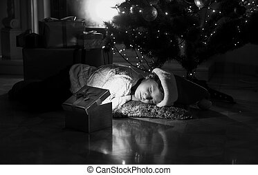 portrait of little girl lying on floor and looking at present