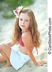 portrait of little girl on the beach