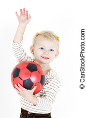 portrait of little girl playing with a ball