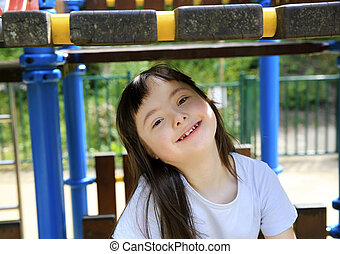 Portrait of little girl smiling in the park