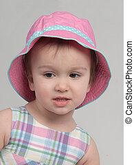 Portrait of little girl wearing panama
