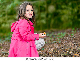 little girl with a cake in hand