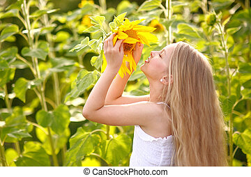 portrait of little girl with a sunflower