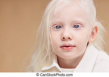 portrait of little girl with albinism syndrome