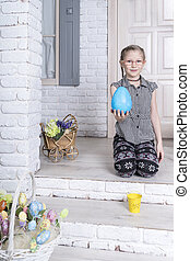portrait of little girl with an egg