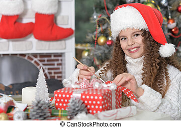 Portrait of little girl with Christmas present