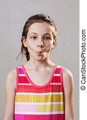 Portrait of little girl with funny fish expression.