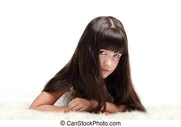 Portrait of little girl with luxuriant long hair