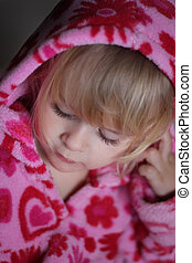 Portrait of little girl with pink hood