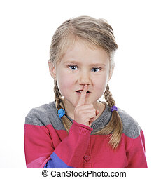 Portrait of little girl with silence gesture