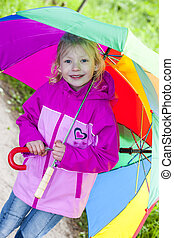 portrait of little girl with umbrellas