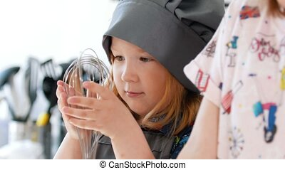 Portrait of little girls preparing to baking cookies