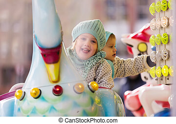 little sisters laughing at roundabout - Portrait of little...