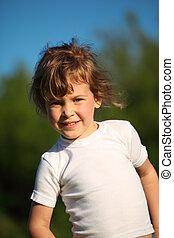 portrait of little smiling girl outdoor