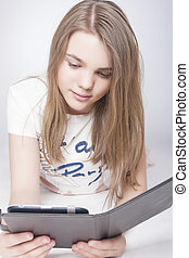 Portrait of Little Teenage Caucasian Girl With Tablet PC