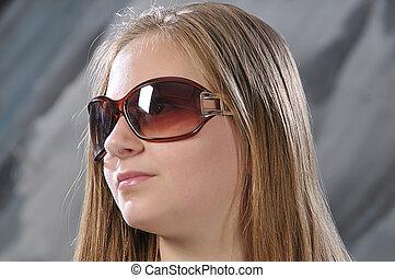 girl is in sun glasses