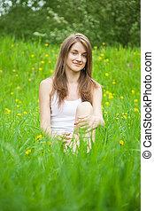 teen girl in grass