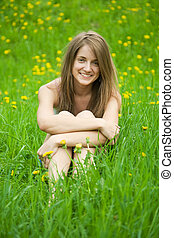 teenager girl in grass