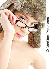 beauty in winter hat and eyeglasses - portrait of lovely...
