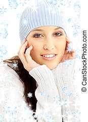 lovely brunette in winter hat with snowflakes