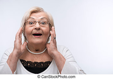 Portrait of lovely grandmother surprised - Grandmother...