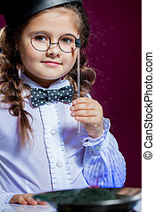 Portrait of lovely little girl posing with glasses
