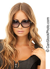 woman in shades - portrait of lovely woman in shades over...