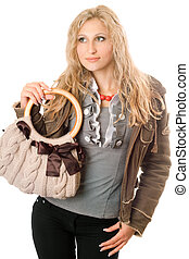Portrait of lovely young blonde with a handbag