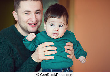 Portrait of loving father with baby boy