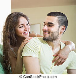 Portrait of loving young couple