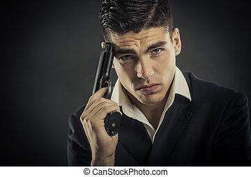 Portrait of mafia man. Selected focus on eyes