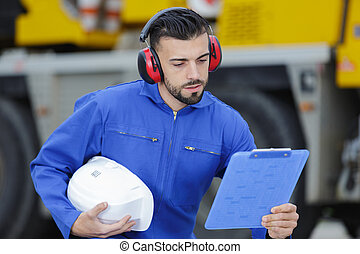 portrait of male aero engineer with clipboard