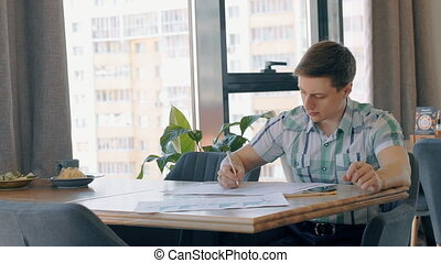 Portrait of male businessman working on market situation...
