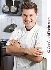 Portrait Of Male Chef Standing In Kitchen