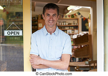 Portrait Of Male Delicatessen Owner Outside Store