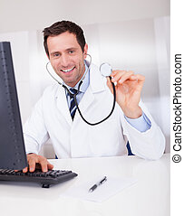 Portrait Of Male Doctor Holding A Stethoscope
