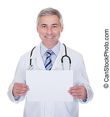 Portrait Of Male Doctor Holding Placard
