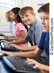 Portrait Of Male Elementary Pupil In Computer Class