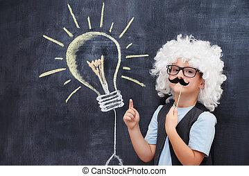 Portrait of male elementary school student in Einstein...