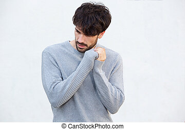 male fashion model with beard against white background