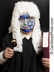 Portrait of male jewish lawyer with painted Israel flag holding judge gavel and book
