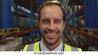 Portrait of male manager in a warehouse