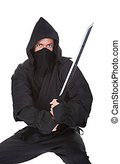 Portrait Of Male Ninja With Weapon Isolated Over White...