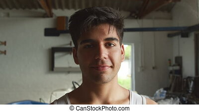 Portrait of male rower looking at the camera - Portrait of a...