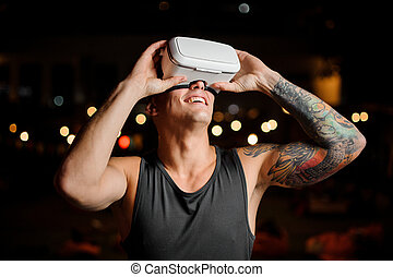 Portrait of man and vr glasses playing an exciting game. Concept of the future.