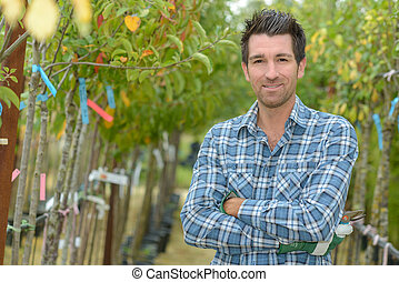 Portrait of man between fruit trees