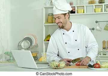 Man cooking in kitchen
